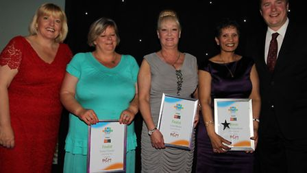 Finalists in the Carer of the Year category, including winner Sonya Chebundrum, second right.