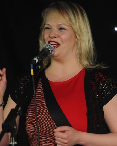 Aimi Percival sings at the Comet Community Awards.