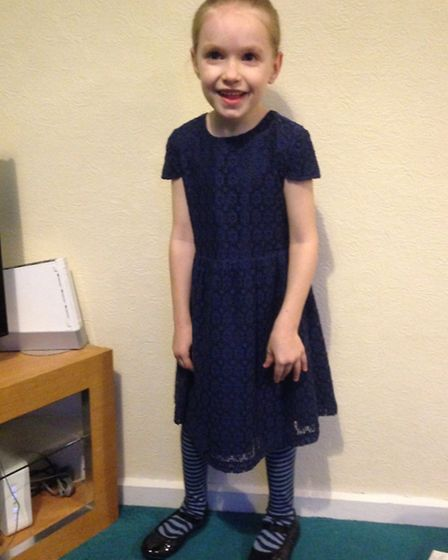 Jen Clare standing independently, wearing 'pretty shoes' she asked for when she no longer had to wea