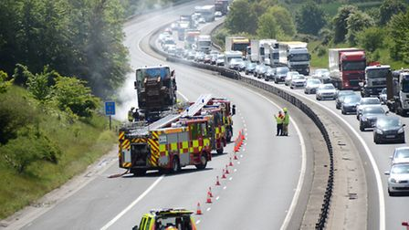 Firefighters tackle lorry blaze on M11 at Littlebury. Picture: Gordon Ridgewell