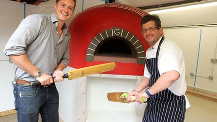 Howard Nye, director at The Cricketer's with Mark Nicholls, Head Chef, next to the pizza oven shaped