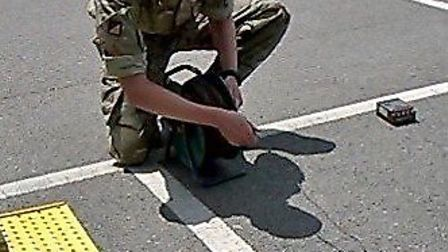 A member of the bomb disposal team sets to work.