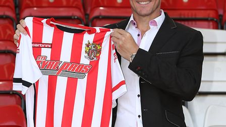New Stevenage manager Teddy Sheringham with the new shirt for the 2015/2016 season