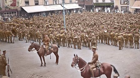 Men from the Warwickshire Regiment parading in Hitchin Market Square. Credit: Colourised by Doug