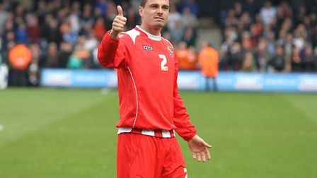 Ronnie Henry gives the fans a thumbs up after the game