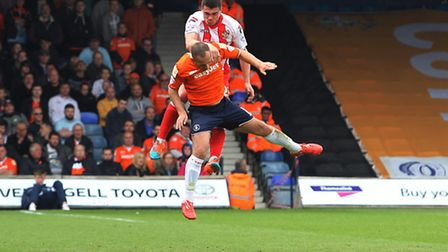 Ronnie Henry wins a header at Luton on Saturday. Photo: Danny Loo