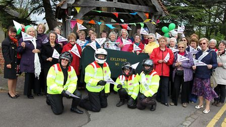 Members of WI and SERV with the WI Baton in Ickleford