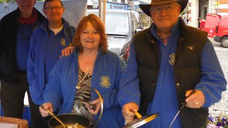 Members of the Rotary Club of Hitchin Tilehouse sell Kurry for Katmandhu in Hitchin Market Place, Ma