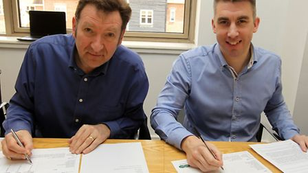 Peter Brooker from PayPoint and Iain Hutchinson of Altro Ltd get down to the business of judging.