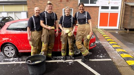 Charity car wash at Stevenage fire station, left to right Carl Robinson, John Oakenfull, Lorraine Sa
