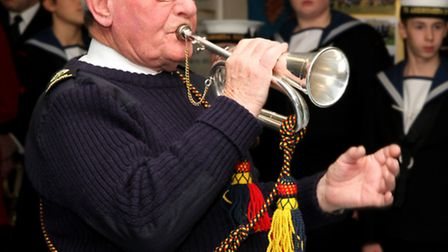 George Bollen playing the bugle.