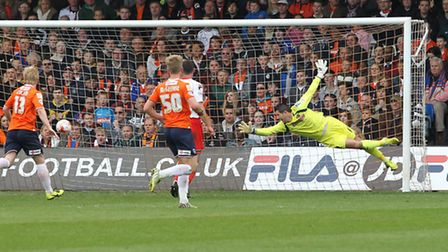 Chris Day dives but sees the shot go wide