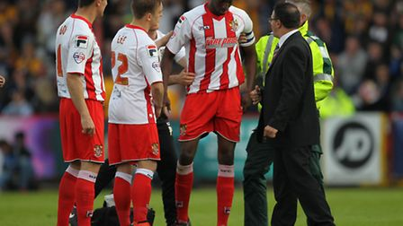 Bira Dembele receives treatment. Photo: Harry Hubbard