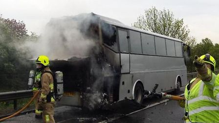 Firefighters tackling the coach fire on the A1(M). Picture: @roadpoliceBCH via Twitter.