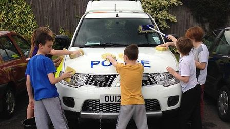 Wilshere Dacre Junior Academy pupils wash police cars on their 'Good Deed Day'