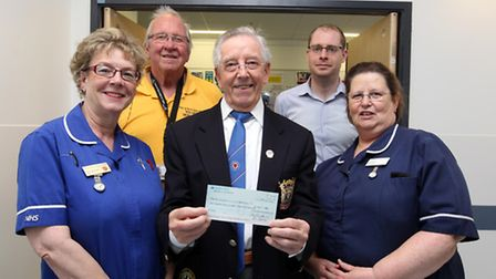 Bernard Drummond, (centre) Zipper's Bowling Association, is donating money to the Cardiac unit, whic