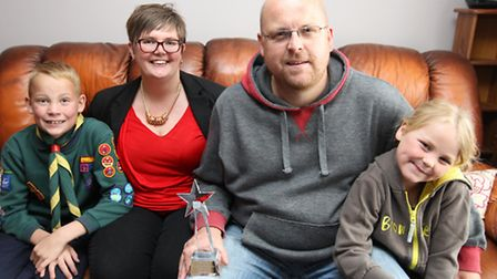 The Jeffrey family, Mark (centre) with his award, Michelle, Alfie and Phoebe.