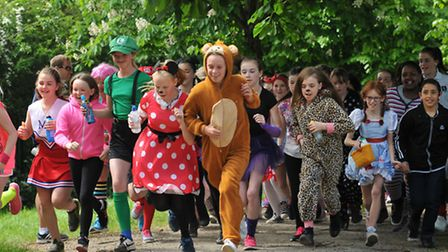 Pupils in fancy dresstake part in the annual fun run at Thomas Alleyne Academy