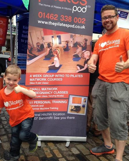 Director Ed Smith promoting The Pilates Pod in Hitchin with his son Dylan.
