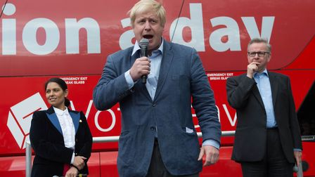Boris Johnson speaks at a rally with Priti Patel and Michael Gove (right) in front of the Vote Leave