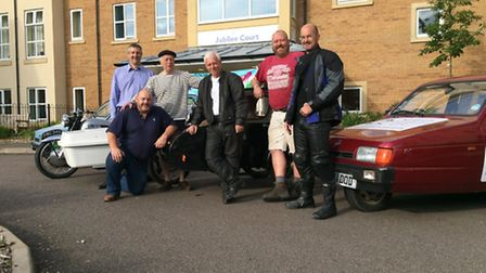 The group with two of their Reliant Robins.