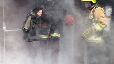 Reporter Oliver Pritchard emerging from the smoke.