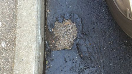 Chunks are missing from the newly-laid road surface in Oundle Court, Stevenage