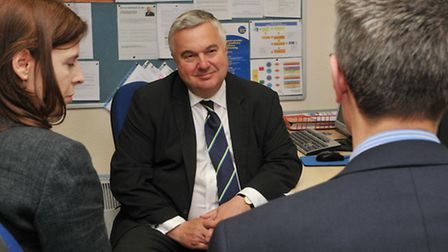 MP Sir Oliver Heald talks with CAB chair of trustees Giles Woodruff and chief executive Rionach Aike