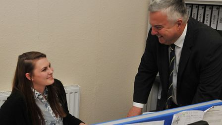 CAB apprentice Natalie Smith talks with MP Sir Oliver Heald during a visit to the Letchworth offices