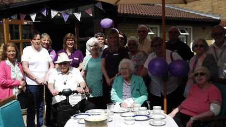 Staff and people who live at the home celebrating its 20th birthday on Friday.