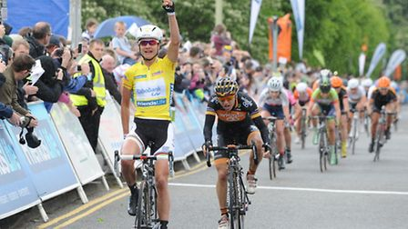 Last year's winner Marianne Vos crosses the finish line in Welwyn Garden City in Stage 4 of the 2014