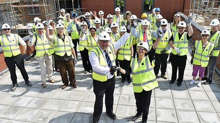 North East Herts MP Sir Oliver Heald performing a topping out ceremony at Letchworth care home, Gard