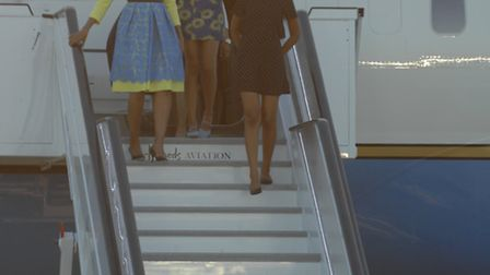 Michelle Obama arrives at Stansted Airport with daughters Sasha and Malia