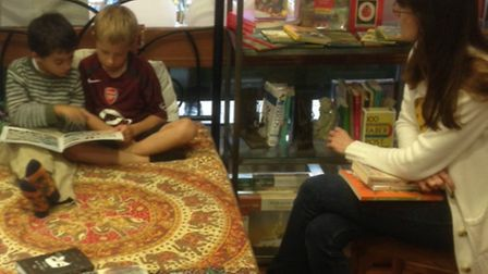 Customers taking part in a 24 hour fundraising bedtime story event at David's Bookshop in Letchworth