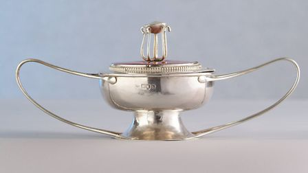 A silver and enamel covered dish and spoon designed by C R Ashbee was sold in 2005 for £17,800.