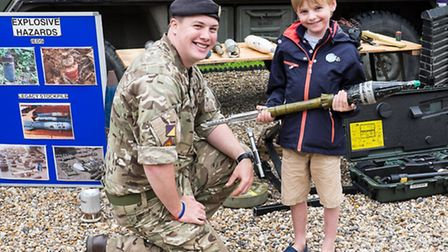 Luca Wilson with the bomb disposal team at Sewards End fete. Picture: Roger King