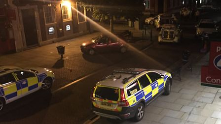 Police vehicles respond to fighting in Hitchin in the early hours of Sunday morning.
