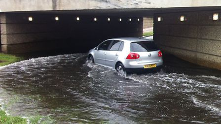 Motorists are being advised not to drive through flood water like in this Stevenage underpass, which