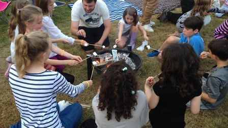 Toasting marshmallows round the fire at RAB Fest