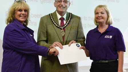 Deputy mayor John Lloyd presents the charity prize to representatives of Riding For The Disabled Ass