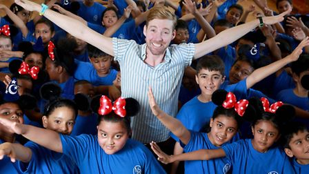 Ricky Wilson takes part in a 10 Minute Shake Up game as part of a schools health promotion backed by
