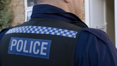 Police are investigating after an elderly woman was threatened on her doorstep.