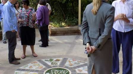 Celebrations to mark 15 years of Triangle Community Garden, Hitchin. The new mosaic at the centre of