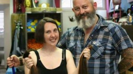 Zoe shows off her new look - and her 22 inches of cut hair - after Felix completes the cut.