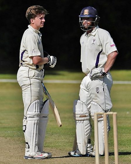 Mark Pettini, right, and Michael Turner meet in the middle during their 116-run partnership. Picture