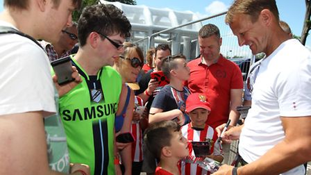 Teddy Sheringham signs autographs for fans