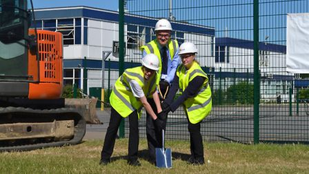 Daniel Townsend and Maisie Moore taking part in the turf cutting ceremony with headteacher Ian Morri