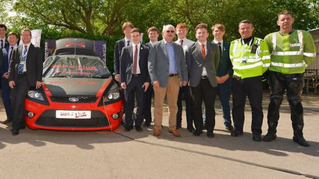 Hertfordshire Road Safety Partnership representatives with sixth form studentsl and the new crash ca