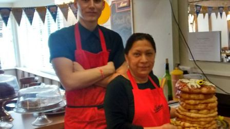 Staff at Tiptree tearooms in Finchingfield with their giant scone baked for Marie Curie