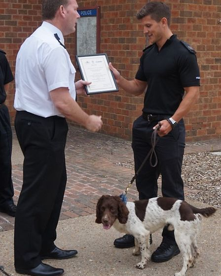 PC Will Wye and police dog Charlie with assistant chief constable Mike Colbourne at the passing out